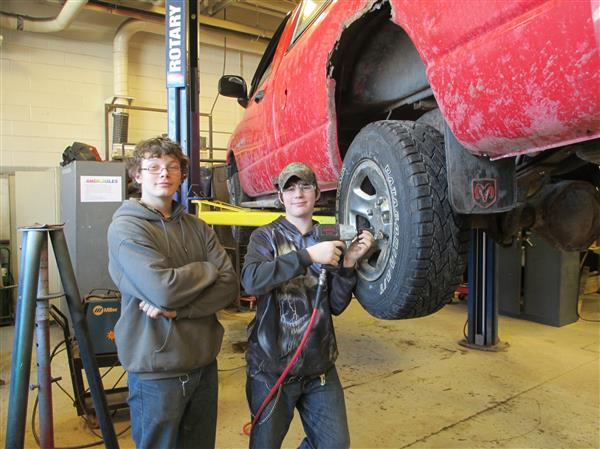 Outdoor Recreation Students working on a car