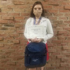 student of the month displaying certificate and backpack