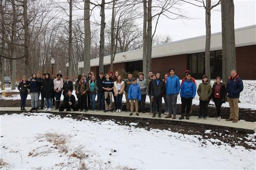 all P-TECH students standing in front of the building at BorgWarner