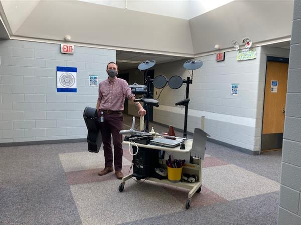 music teacher Dan Collins with mobile music cart