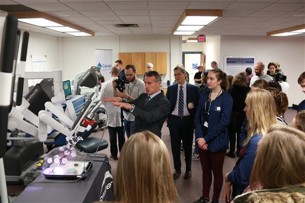 Experts demonstrating how to use the surgical robot